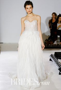 Brides.com: . Style 3654, ivory textured net ball gown, strapless sweetheart neckline with keyhole back, ivory petal embroidered net over cashmere Chantilly lace bodice, natural waist tutted A-line skirt, Lazaro