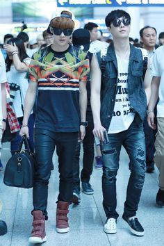 Lay looks like he is thinking oh shit this is not a pair of shoes. It's two different shoes. Why isn't my closet as organized as Xiumin's