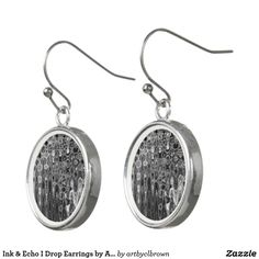 """Wear these unique sterling silver-plated drop earrings for any occasion. The Ink & Echo I Drop Earrings designed by Artist C.L. Brown feature an abstract kinetic light painting design enhanced with Photoshop. Earrings are silver plated, water-resistant, and have a fade-proof print sealed with a UV-resistant coating. This product is recommended for ages 13+ and has dimensions of 0.7"""" diameter. Made in USA."""