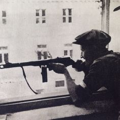 Early August 1944, Warsaw. Insurgent position in one of the houses on Nowy Świat Street next to Foksal Street.  Source: Dni Powstania