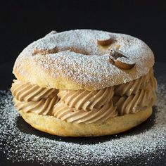 Paris-Brest is a ring made of choux pastry, usually filled with crème mousseline – which is a pastry cream enriched with butter. Paris Brest, Choux Pastry, Bagel, Doughnut, Meal Prep, Deserts, Butter, Sweets, Lunch