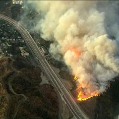 Getty fire off 405 Freeway in L. destroys several homes; thousands flee Fire, Homes, Train, Houses, Home, Strollers, Computer Case