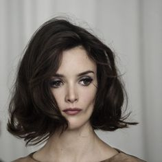 Short and wavy chic 60s hairstyle and makeup. Hair muse Charlotte Le Bon from the film YSL.