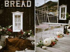 white pumpkin aisle decor + cow hide wedding decor. black bottles, fall foliage. oak barrel decor. Bread Bar, a&be,  Lale Florals, Laurel & Rose www.laurelandrose.com