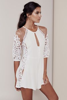 A show stopping blend of white crochet lace trimming and nude tulle, For Love & Lemons Valentina Romper is made to keep the heart fluttering. Featuring a darling keyhole and buttons at the neckline, t