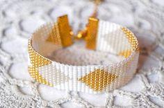 Bead loom bracelet, diamond pattern , argyle pattern czech glass bead bracelet, white, gold, wide cuff bracelet, golden from Bracelicious on Etsy.