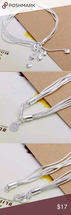 Sterling Silver Hanging Hearts Bracelet A beautiful hanging heart bracelet.with a 5 strands with a heart on the bottom.  The strands run through a silver loop so the strands can vary.  Non Smoking/pet friendly home Jewelry Bracelets