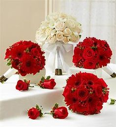 our boquets   Red and White Personal Package (1 White  Bridal Bouquet, 3 Bridesmaid Bouquets and 4 Boutonnieres