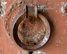 Rusty old door knocker-- would make a cool towel holder.