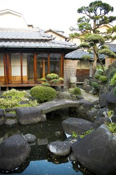 Japanese- A wrap around porch and low pitch roofs are typical. Water features and bonzai trees with plants and rocks help designate these from other Asian homes.