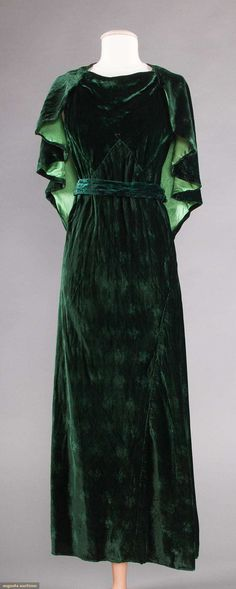 Lovely 1930s forest green foral embossed velvet evening gown. Sleeveless withbl attached capelet and belt.