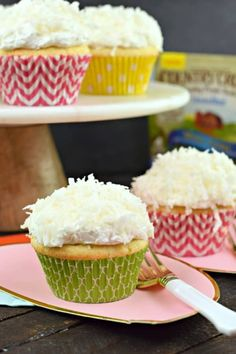 Lemon Ricotta cupcakes with coconut buttercream frosting and filled with lemon curd #sponsored #countrycrock #cupcakes