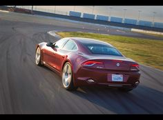 The Fisker Karma exemplifying that the Karma is not only eco-friendly, but also track friendly