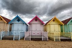 Pastel coloured Beach huts at West Mersea, Essex, England