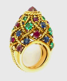 Cartier, Paris Ruby, Emerald and Sapphire Temple Ring.