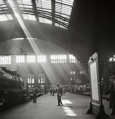 Roman Vishniac :: Sunlight streaming into a railway station, probably the Bahnhof Zoo terminal in Charlottenburg, Berlin, late 1920′s - early 1930′s  more [+] by R. Vishniac