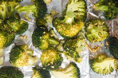 Roasted Garlic Broccoli - broccoli, garlic cloves, olive oil, kosher salt, black pepper, cooking spray