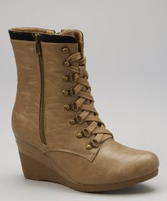 Navigate city streets like a style warrior with these slick wedge boots. The rugged lace-up design and sturdy heel make for a high-fashion, high-impact look.3.25'' heel8.5'' shaft10.75'' circumferenceZipper / lace-up closureMan-madeImported
