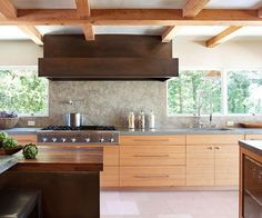 Contemporary style doesn't need to be cold and hard as this warm, inviting kitchen shows.