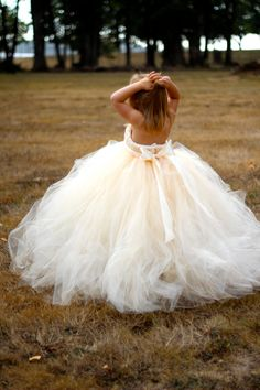 Love all the tulle but I probably wouldn't have a little flower girl in a strapless dress