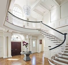 Entry hall by Jay Gleysteen architecture and designer Kate Coughlin, near Boston. New Enlgand Home. Entry foyer and stairs. Villa Plan, Grand Staircase, Staircase Design, Dark Staircase, Winding Staircase, Staircase Ideas, Spiral Staircases, Foyer Design, New England Homes