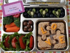 """Puzzle sandwich with cheddar letters to spell out """"LOVE"""" Lettuce and tomato (to put on the sandwich) Kiwi hearts with blueberries Carrots and broccoli with ranch Peanut Butter/Pretzel chocolate balls Peanut Butter Pretzel, Kids Lunch For School, School Lunches, School Ideas, Sandwich Cutters, Stainless Steel Lunch Box, Love You To Pieces, Food Now"""