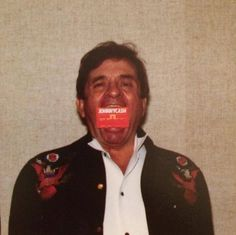 Johnny Cash clowning around with a Canada Trust card in his mouth after Canada Trust had a campaign featuring a Johnny Cash Money Machine. 1985