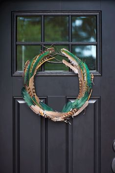 DIY feather wreath  For all of our creative residents who love to decorate their front door - here's an awesome idea!