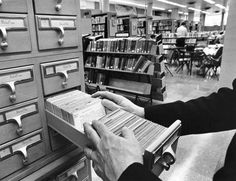 People using Cincinnati Public Library Card Catalog... oh wow.. I used to LOVE LOVE LOVE spending time like this...   I am sooo grateful that a photographer thought to take this image!