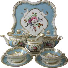 Nineteenth century Jacob Petit Paris porcelain cabaret tea service having a sevres blue ground decorated with hand painted floral bouquets picked out