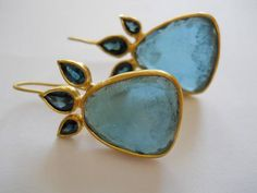 Unique Gold Blue Tourmaline Earrings - Large flat surface Teal colored Tourmalines with 3 smaller pear shaped stones at the top. Tourmaline Earrings, Blue Tourmaline, Teal Colors, Pear Shaped, Etsy Earrings, Mirrored Sunglasses, Gemstone Rings, Brooch, Dominique