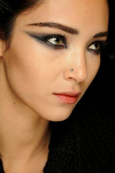Runway make-up, backstage at Jean Paul Gaultier Spring/Summer 2013 Couture at Paris Fashion Week.