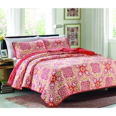 Stay warm and cozy on cool nights with this three-piece quilt set. Set includes coverlet and two shams. Constructed with a 50/50 cotton and poly blend that's machine washable.