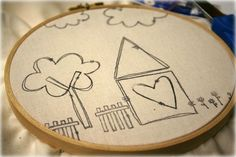 Stamp it and then stitch over it!  I bought some garage sale embroidering hoops, so thinking I need to try this!!