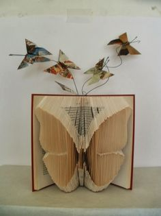 book sculpture butterfly by clara maffei book sculpture butterfly by clara maffei Folded Book Art, Paper Book, Paper Art, Paper Crafts, Cut Paper, Old Book Crafts, Book Page Crafts, Recycled Books, Book Projects