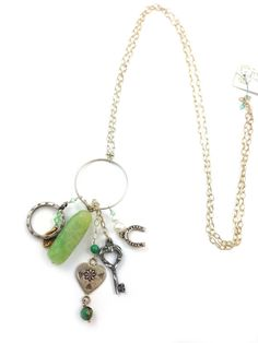 """This elegant necklace a cluster of colorful green charms dangle of gemstones, swarovski crystal and various sterling silver shape from a sterling silver circle and chain 28"""" in length. Pair it with a beautiful dress and you're ready to go.  Handmade by myself, Stacee Gillelen."""