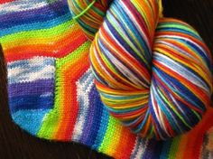sweet rainbows & clouds self striping yarn.