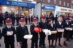 Year 2 pupils took part in Bromsgrove's 'Day of Kindness' by handing out cakes in the town.
