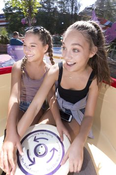 Mackenzie Ziegler Photos Photos - In this handout photo provided by Disneyland Resort, sisters Mackenzie Ziegler and Maddie Ziegler take a spin in a teacup at the Mad Tea Party at Disneyland park August 18, 2016 in Anaheim, California. - Mackenzie Ziegler and Maddie Ziegler Take a Spin at Disneyland