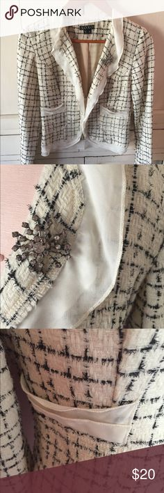 Off White tweed suit jacket Off White tweed jacket with lace trim. Has lace around collar, pockets,bottom of sleeves and bottom of jacket. Has super cute broach on left lapel. Armpit to armpit it measures 15 in. Has two metal hook and eye closers. XOXO Jackets & Coats Blazers