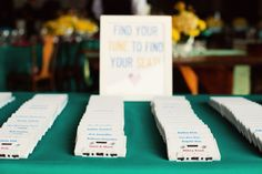 A Beatles Themed Wedding.  Instead of place cards, cassettes were used for guests to find their seating.