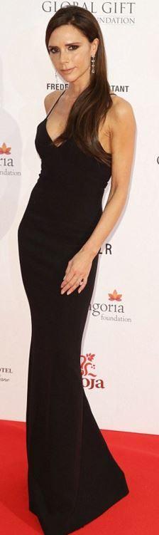 Who made  Victoria Beckham's black spaghetti strap gown?