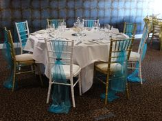 Wedding breakfast set up with ice blue organza sashes, finished with bronze details.  Want your own quote? Then email me with your ideas! hello@beckiemelvinevents.co.uk  More styles can be seen at www.beckiemelvinevents.co.uk