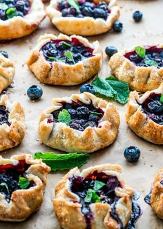 These Mini Blueberry Galettes are perfect for a quick dessert. They're perfectly crisp, flaky, delicious and so impressive. The ultimate summer dessert! Tiramisu Dessert, Pie Dessert, Quick Dessert, Dessert Recipes, Berry Galette Recipe, Gallette Recipe, Blueberry Galette, Tart Recipes, Sweet Recipes