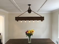 4 ft Rustic Beam Edison Bulb Chandelier With Vintage Barn Pulley by HandCraftedLighting on Etsy https://www.etsy.com/listing/215846612/4-ft-rustic-beam-edison-bulb-chandelier