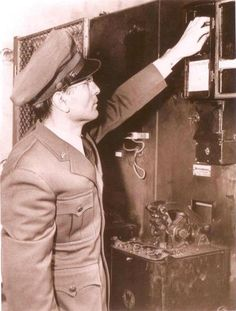 Lady Liberty remained dark during World War II, her lights were briefly relit on two occasions, the second of which was May 8, 1945. In this photo, Superintendent George Palmer throws the switch to relight the torch to mark the surrender of Germany.