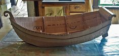step by step on how to make a cool boat from cardboard