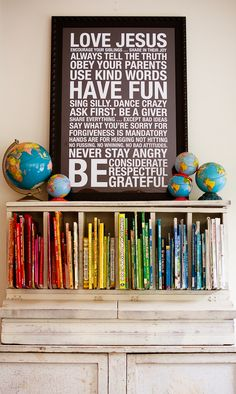 I don't know what's better: the color coded kids books, the little globes, or the subway art of family rules! Ideas Prácticas, Den Ideas, Craft Ideas, Wall Ideas, Family Rules, The Design Files, Subway Art, Do It Yourself Home, Art Deco