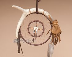 "Deer Skin Medicine Bag - Antler Dream Catcher 6"" This is an authentic Navajo Indian deer skin medicine bag with a combination dream catcher and medicine wheel on a real white tail deer antler. One of a kind, actual piece is shown. 6"" hoop. Authentic Native American, Tribe: Navajo   Price: $109.95 Sale Price: $79.95"