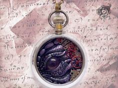 The Guardian of Erebor Dragon pocket watch pendant with dragon's breath fire opal - polymer clay and fantasy steampunk clockwork + rubies